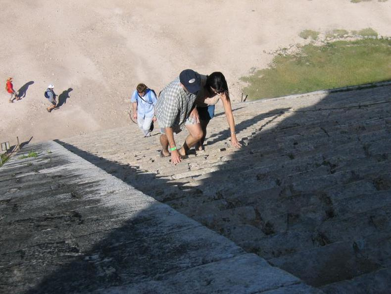 People climbing up the step-pyramid